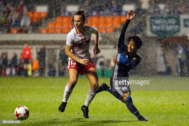 Mana Iwabuchi of Japan and Lia Walti of Switzerland compete for the ball during the international friendly match between Japan and Switzerland at...