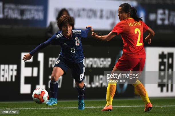 Mana Iwabuchi of Japan and Liu Shanshan of China compete for the ball during the EAFF E1 Women's Football Championship between Japan and China at...