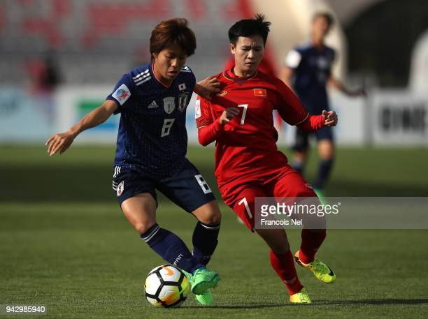 Mana Iwabuchi of Japan and Nguyen Thi Tuyet Dung of Vietnam in action during the AFC Women's Asian Cup Group B match between Japan and Vietnam at the...