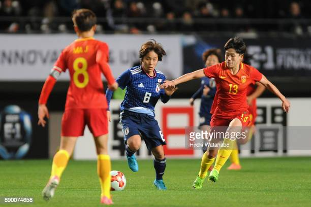 Mana Iwabuchi of Japan and Pang Fengyue of China compete for the ball during the EAFF E1 Women's Football Championship between Japan and China at...