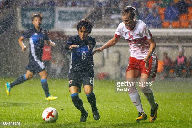 Mana Iwabuchi of Japan and Rahel Kiwic of Switzerland compete for the ball during the international friendly match between Japan and Switzerland at...