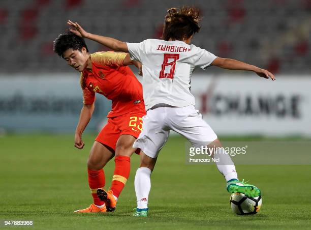 Mana Iwabuchi of Japan and Ren Guixin of China battle for the ball during the AFC Women's Asian Cup semi final match between China and Japan at the...