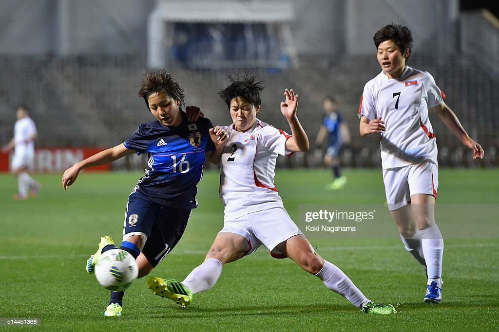 Mana Iwabuchi of Japan and Ri Hui Jong of North Korea compete for the ball during the AFC Women's Olympic Final Qualification Round match between Japan and North Korea at Kincho Stadium on March 9, 2016 in Osaka, Japan.
