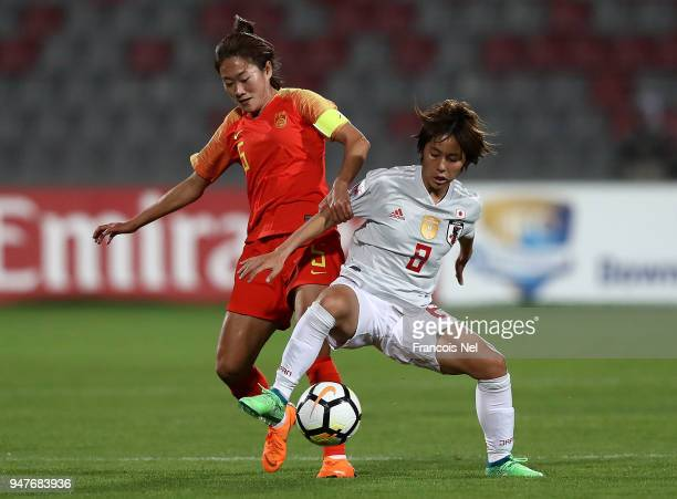 Mana Iwabuchi of Japan and Wu Haiyan of China battle for the ball during the AFC Women's Asian Cup semi final match between China and Japan at the...
