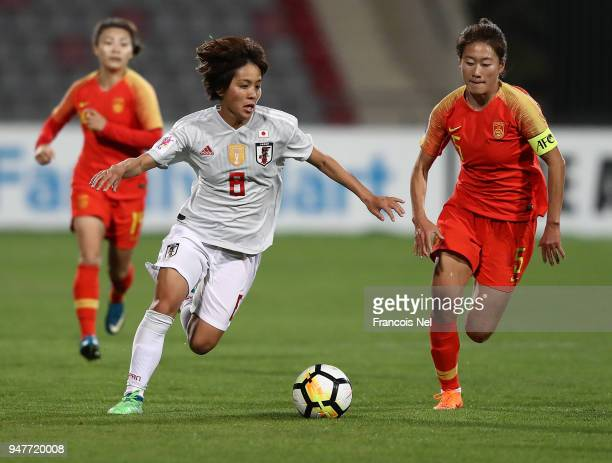 Mana Iwabuchi of Japan and Wu Haiyan of China in action during the AFC Women's Asian Cup semi final match between China and Japan at the King...