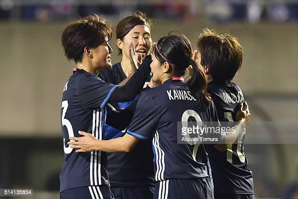Mana Iwabuchi of Japan celebrates scoring her team's first goal with her team mates Saori Ariyoshi Yuri Kawamura and Nahomi Kawasumi during the AFC...