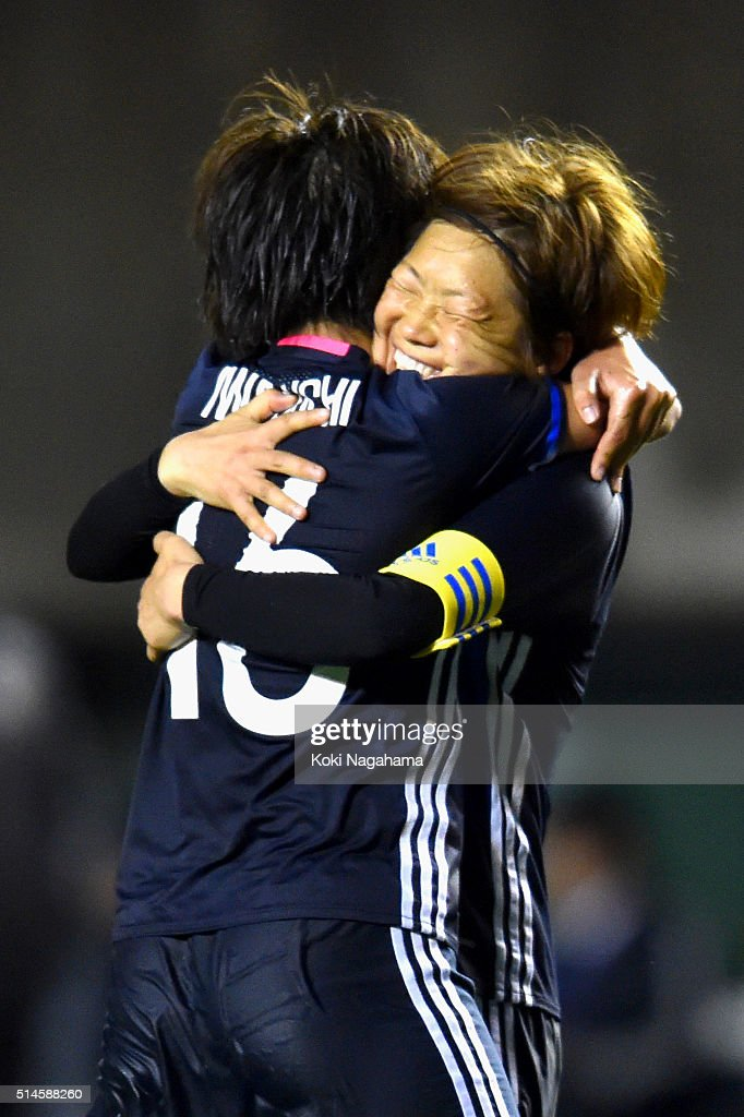 Mana Iwabuchi (L) of Japan celebrates scoring her team's first goal with her team mate Aya Miyama (R) during the AFC Women's Olympic Final Qualification Round match between Japan and North Korea at Kincho Stadium on March 9, 2016 in Osaka, Japan.