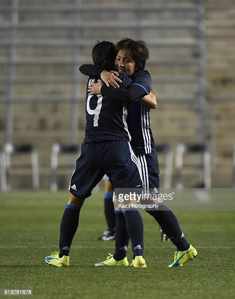 Mana Iwabuchi of Japan celebrates the opener with Kawasumi Nahomi of Japan during the AFC Women's Olympic Final Qualification Round match between...