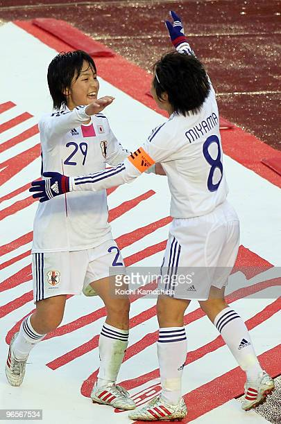 Mana Iwabuchi of Japan celebrates with her teammates Aya MIyama after scoring a goal during the East Asian Football Federation Women's Football...