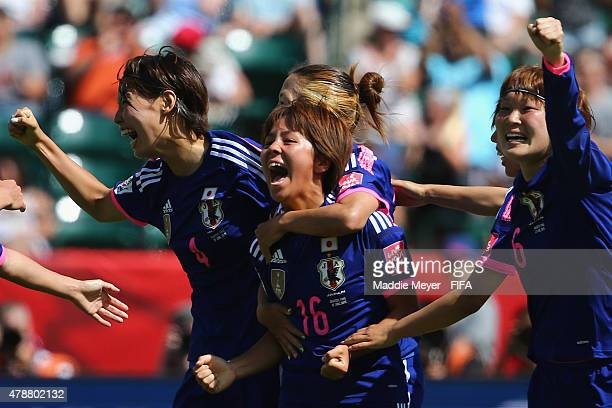 Mana Iwabuchi of Japan celebrates with teammates after scoring a goal during the FIFA Women's World Cup Canada 2015 quarter final match between Japan...