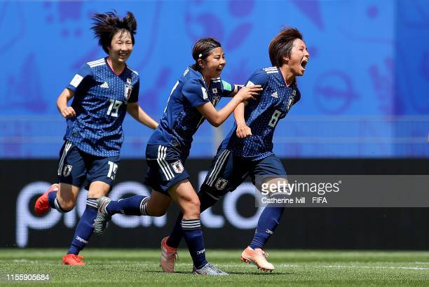 Mana Iwabuchi of Japan celebrates with teammates after scoring her team's first goal during the 2019 FIFA Women's World Cup France group D match...