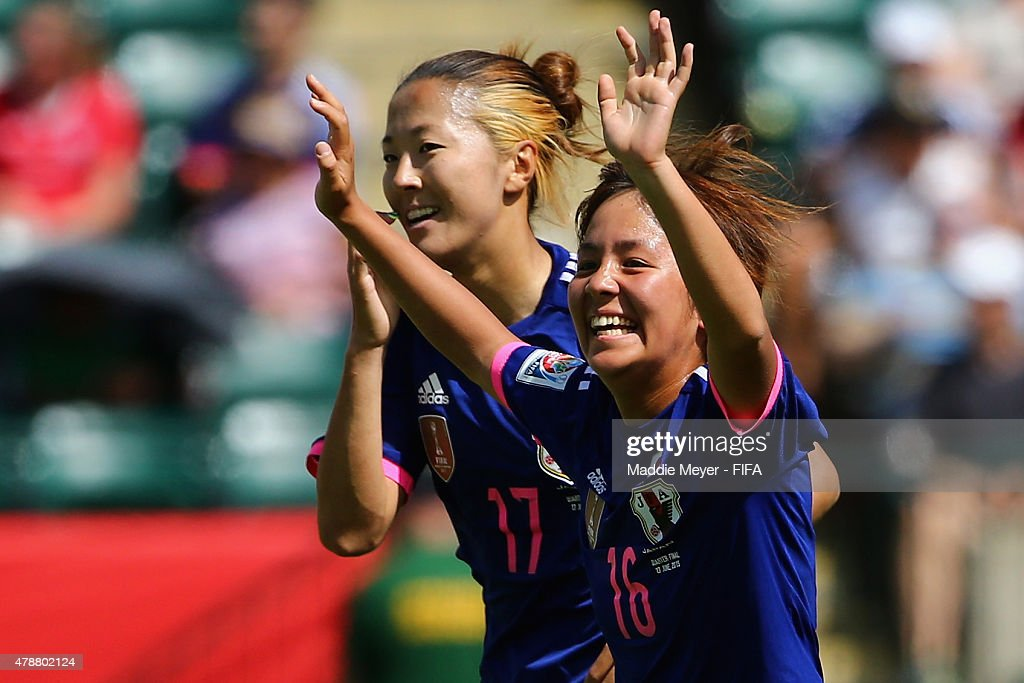 Mana Iwabuchi #16 of Japan celebrates with Yuki Ogimi #17 after scoring a goal during the FIFA Women's World Cup Canada 2015 quarter final match between Japan and Australia at Commonwealth Stadium on June 27, 2015 in Edmonton, Alberta, Canada.
