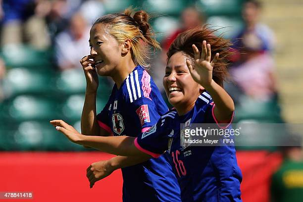 Mana Iwabuchi of Japan celebrates with Yuki Ogimi after scoring a goal during the FIFA Women's World Cup Canada 2015 quarter final match between...