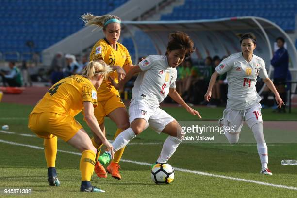 Mana Iwabuchi of Japan challenges for the ball with Clare Polkinghorne and Ellie Carpenter of Australia during the AFC Women's Asian Cup Group B...