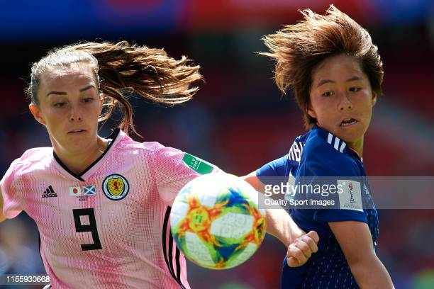 Mana Iwabuchi of Japan competes for the ball with Caroline Weir of Scotland during the 2019 FIFA Women's World Cup France group D match between Japan...