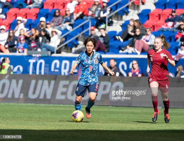 Mana Iwabuchi of Japan controls ball during SheBelieves Cup game against England at Red Bull Arena. England won 1 - 0.