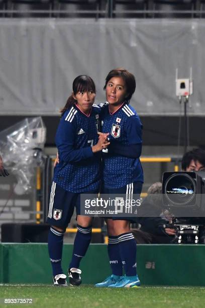 Mana Iwabuchi of Japan embraces Emi Nakajima after replaced during the EAFF E1 Women's Football Championship between Japan and North Korea at Fukuda...
