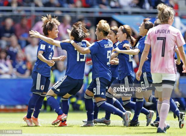 Mana Iwabuchi of Japan is congratulated by teammates after opening the scoring during the first half of a Women's World Cup Group D match against...