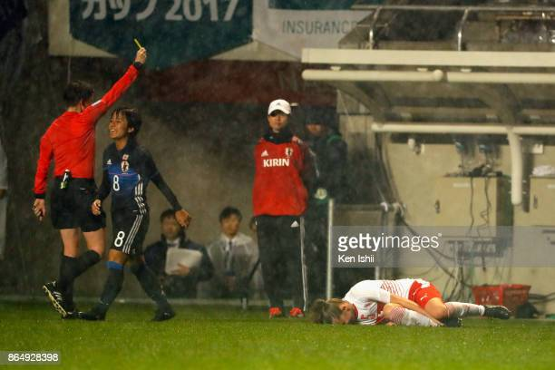Mana Iwabuchi of Japan is shown a yellow card during the international friendly match between Japan and Switzerland at Nagano U Stadium on October 22...