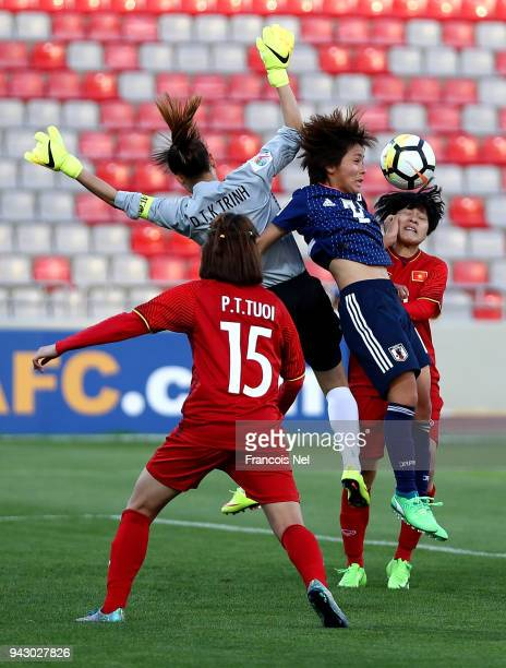 Mana Iwabuchi of Japan jumps to the ball during the AFC Women's Asian Cup Group B match between Japan and Vietnam at the King Abdullah II Stadium on...
