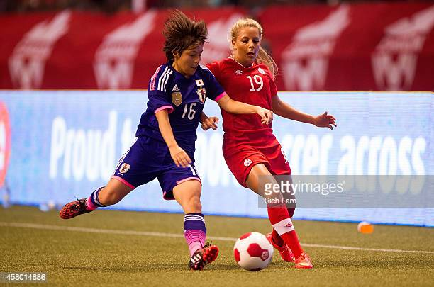 Mana Iwabuchi of Japan knocks the ball away from Adriana Leon of Canada in Women's International Soccer Friendly Series action on October 28 2014 at...
