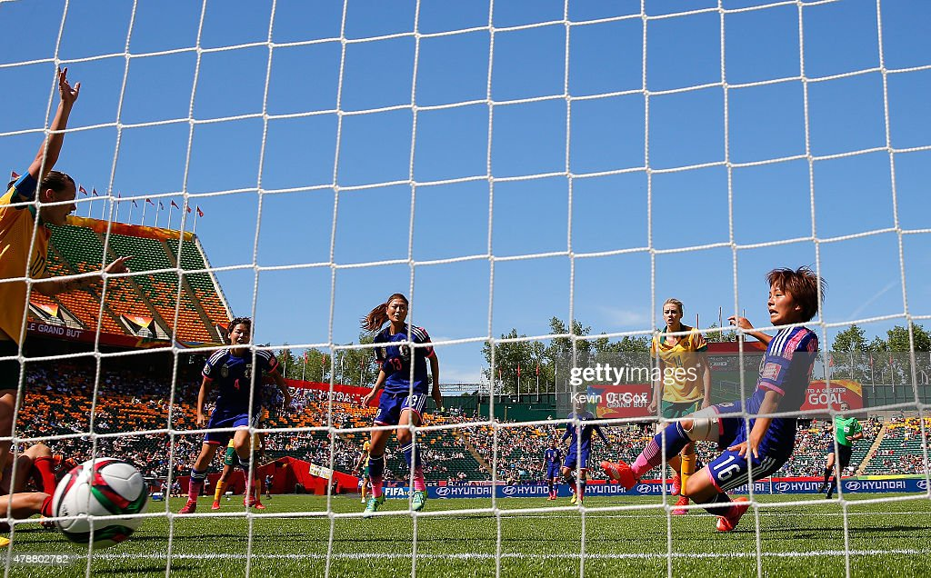 Mana Iwabuchi #16 of Japan scores their first goal against Australia during the FIFA Women's World Cup Canada 2015 Quarter Final match between Australia and Japan at Commonwealth Stadium on June 27, 2015 in Edmonton, Canada.