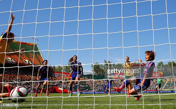 Mana Iwabuchi of Japan scores their first goal against Australia during the FIFA Women's World Cup Canada 2015 Quarter Final match between Australia...