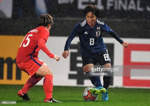 Mana Iwabuchi of Japan takes on Lee Sodam of South Korea during the EAFF E1 Women's Football Championship between Japan and South Korea at Fukuda...
