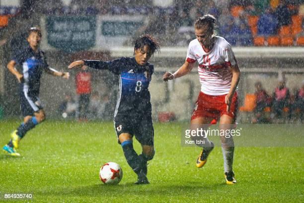 Mana Iwabuchi of Japan takes on Rahel Kiwic of Switzerland during the international friendly match between Japan and Switzerland at Nagano U Stadium...