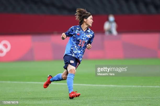 Mana Iwabuchi of Team Japan celebrates after scoring their side's first goal during the Women's First Round Group E match between Japan and Canada...