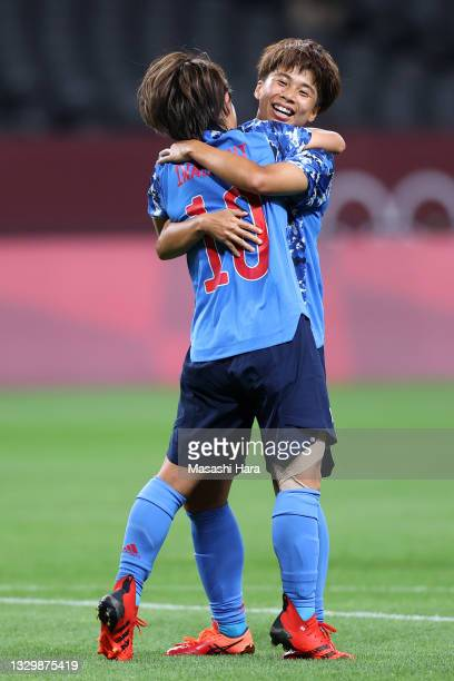 Mana Iwabuchi of Team Japan celebrates with teammate Mina Tanaka after scoring their side's first goal during the Women's First Round Group E match...