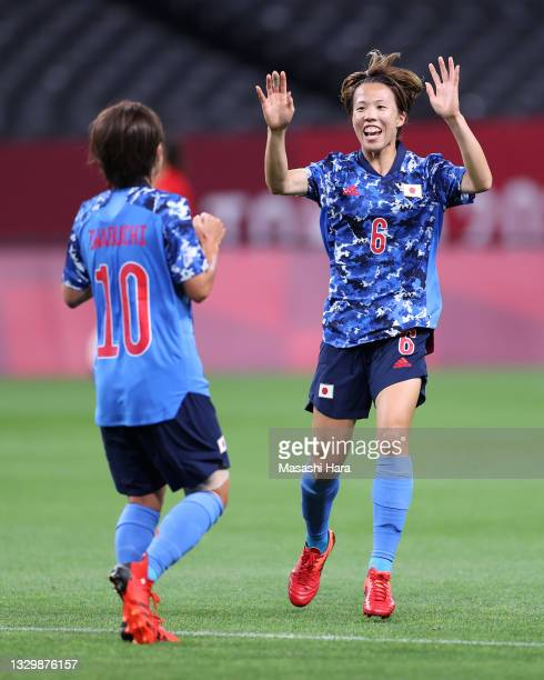 Mana Iwabuchi of Team Japan is congratulated by teammate Hina Sugita after scoring their side's first goal during the Women's First Round Group E...