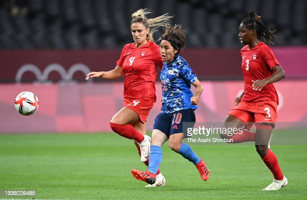 Mana Iwabuchi of Team Japan scores her side's first goal during the Women's First Round Group E match between Japan and Canada during the Tokyo 2020...