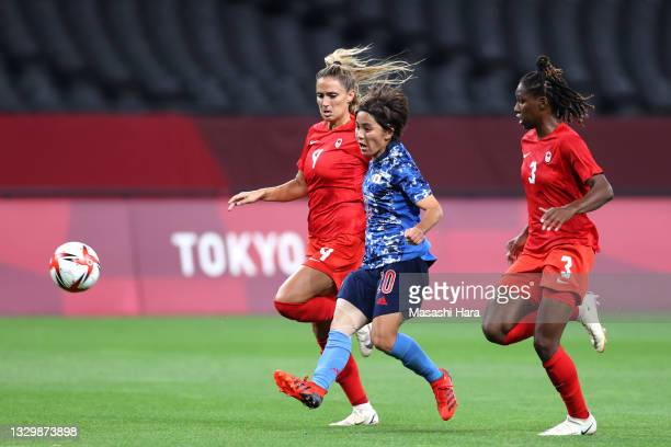 Mana Iwabuchi of Team Japan scores their side's first goal during the Women's First Round Group E match between Japan and Canada during the Tokyo...