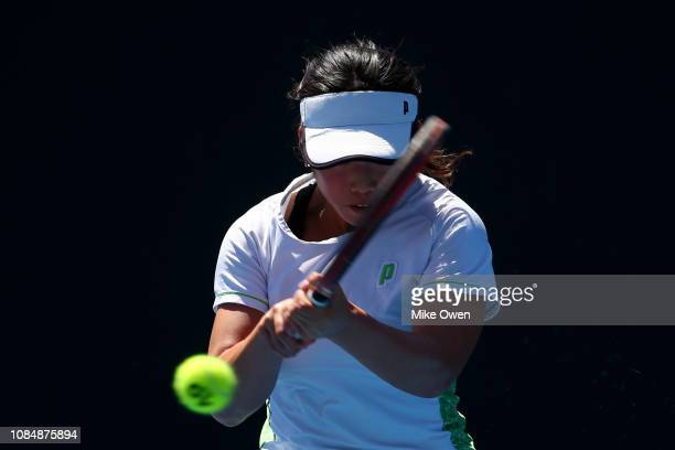 Mana Kawamura of Japan plays a backhand in her first round Junior Girls' Singles match against Amber Marshall of Australia during day six of the 2019...