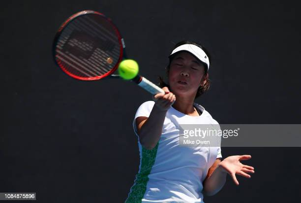 Mana Kawamura of Japan plays a forehand in her first round Junior Girls' Singles match against Amber Marshall of Australia during day six of the 2019...
