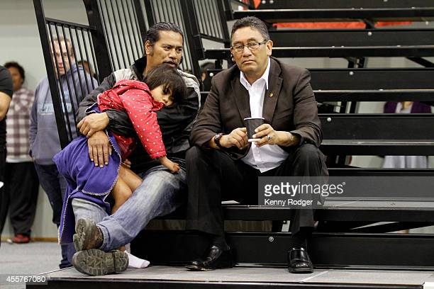 Mana Party Leader Hone Harawira watches television coverage alongside a supporter at Te Rangi Aniwaniwa School on September 20 2014 in Awanui New...