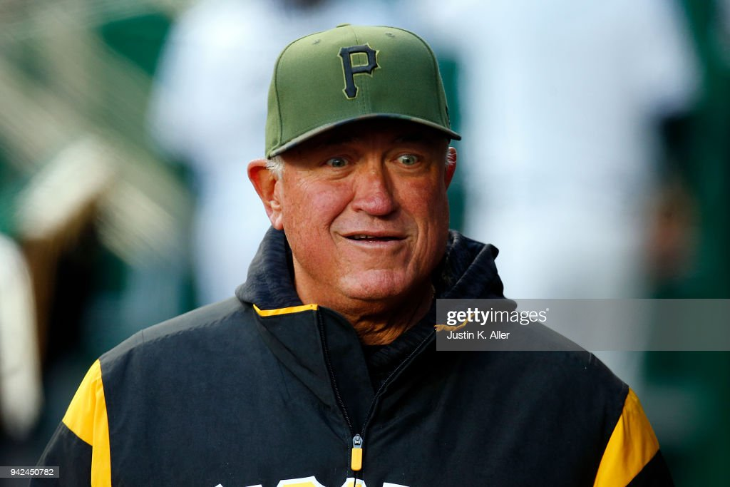 Manaager Clint Hurdle #13 of the Pittsburgh Pirates jokes in the dugout against the Cincinnati Reds at PNC Park on April 5, 2018 in Pittsburgh, Pennsylvania.