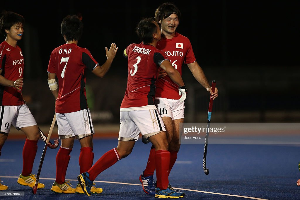 Manabu Hatakeyama of Japan is congratulated by Koji Kayukawa after scoring a goal during the Test Match between the New Zealand Black Sticks and Japan at Blake Park on March 12, 2014 in Mount Maunganui, New Zealand.