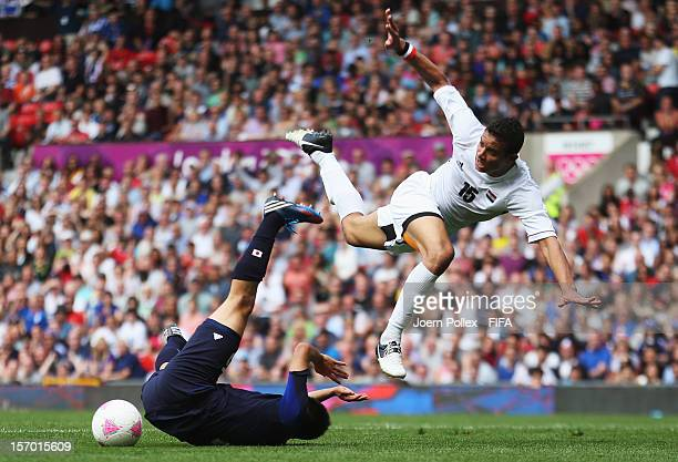 Manabu Saito of Japan and Saadeldin Saad of Egypt compete for the ball during the Men's Football Quarter Final match between Japan and Egypt, on Day...