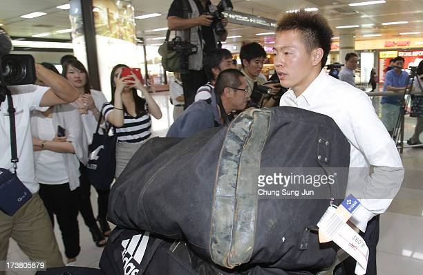 Manabu Saito of Japan arrives ahead of the 2013 EAFF East Asian Cup at the Gimpo International Airport on July 18, 2013 in Seoul, South Korea.
