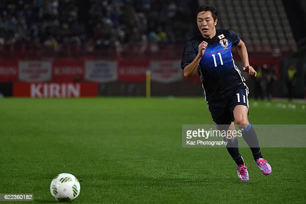 Manabu Saito of Japan dribbles the ball during the international friendly match between Japan and Oman at Kashima Soccer Stadium on November 11, 2016...