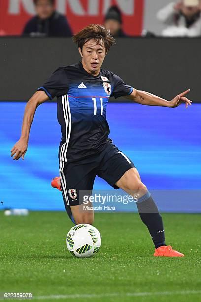 Manabu Saito of Japan in action during the international friendly match between Japan and Oman at Kashima Soccer Stadium on November 11, 2016 in...
