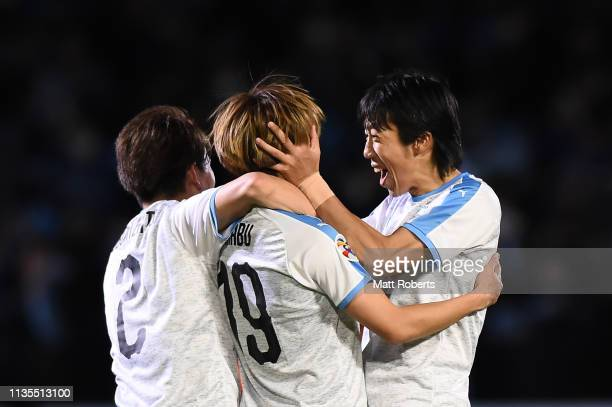 Manabu Saito of Kawasaki Frontale celebrates scoring a goal Kyohei Noborizato and Kengo Nakamura during the AFC Champions League Group H match...