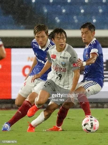 Manabu Saito of Kawasaki Frontale controls the ball under pressure from defenders of Yokohama F.Marinos during the J.League Meiji Yasuda J1 match...
