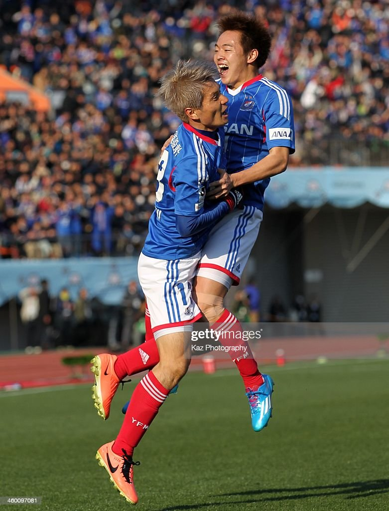 Manabu Saito (R) of Yokohama F.Marinos celebrate scoring his team's first goal with his team mate Yuzo Kobayashi during the 93rd Emperor's Cup final between Yokohama F.Marinos and Sanfrecce Hiroshima at the National Stadium on January 1, 2014 in Tokyo, Japan.