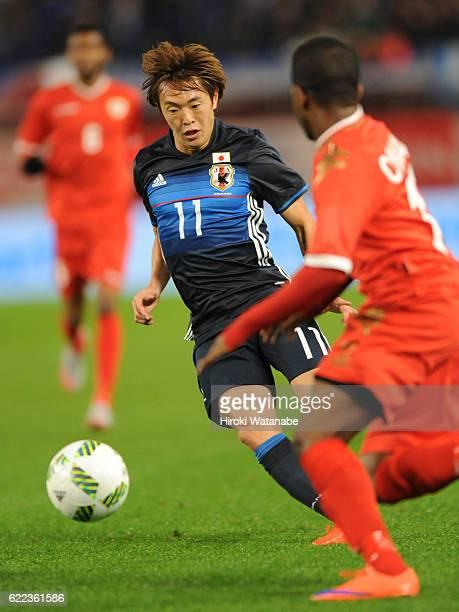 Manabu Saito Osako of japan in action during the international friendly match between Japan and Oman at Kashima Soccer Stadium on November 11, 2016...