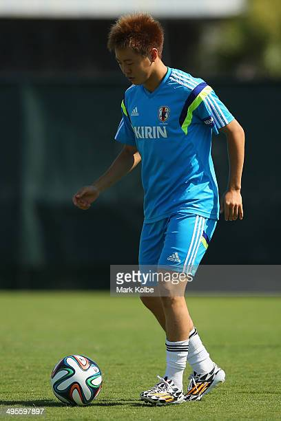 Manabu Saito runs with the ball during a Japan training session at North Greenwood Recreation & Aquatic Complex on June 4, 2014 in Clearwater,...