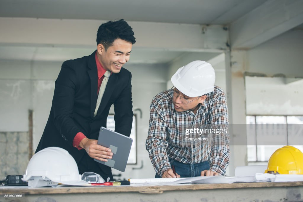 Management consulting with engineers working with blueprint and management consulting with engineers working with blueprint and drawing on work table malvernweather Choice Image