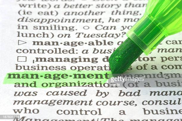 management definition highligted in dictionary